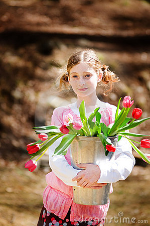Girl with a bucket of tulips