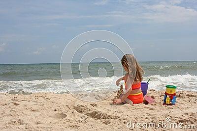 Girl building sand castle 2