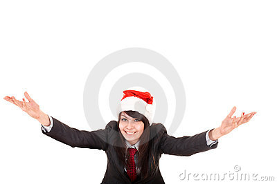 Girl in business suit, santa hat with arms raised.