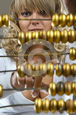 Girl calculating with an abacus