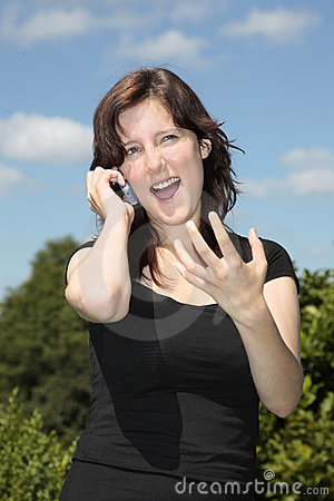 Girl calling by cell phone gesturing w hand