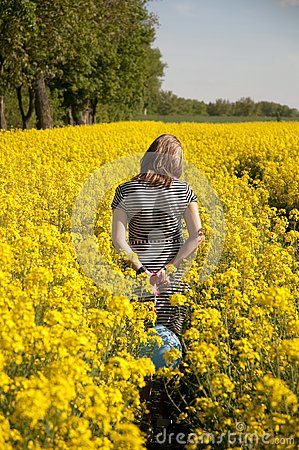 Girl on canola field