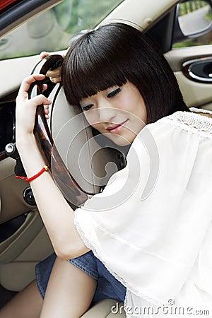 Girl in the car.