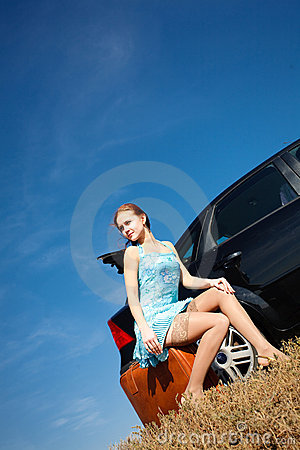 Girl by the car