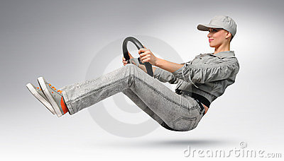 Girl car driver with a wheel