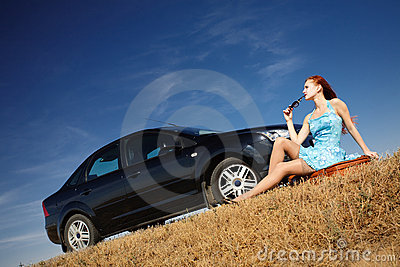 Girl by the car with sunglasses