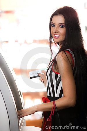 Girl with card and cash dispenser