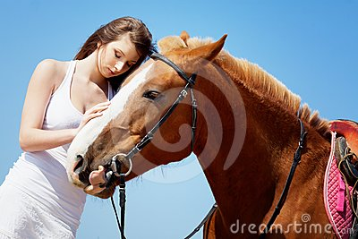 Girl caress her horse