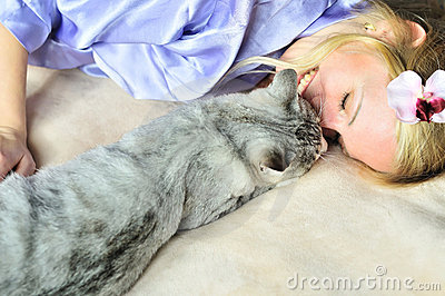 Girl with caressing cat