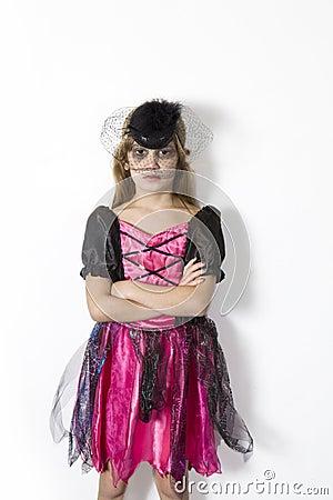 Girl in carnival fancy dress on the eve of Hallowe