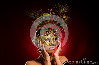 Girl with carnival mask in hand
