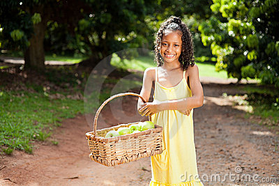 Girl carrying apples