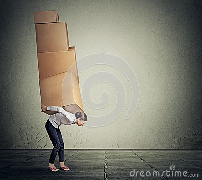 Free Girl Carrying Several Boxes On Her Back In Equilibrium Royalty Free Stock Photography - 57640567