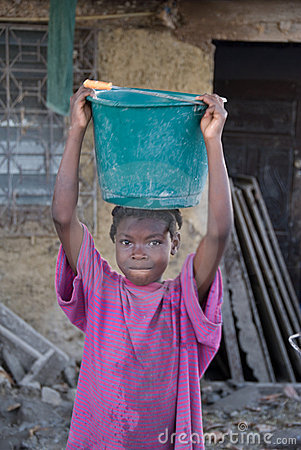 Girl Carrying Water Editorial Image