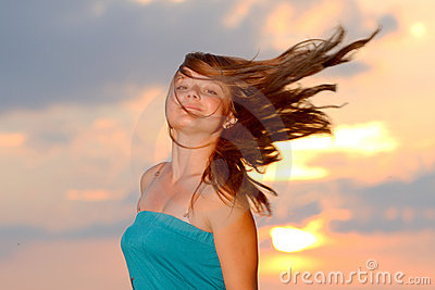 Girl with casual style wear against sunset sky