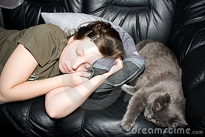 Girl and cat a sleep