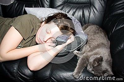 Girl and cat a sleep