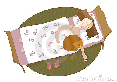 The girl and a cat sleep on a bed