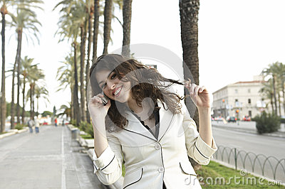Girl with Cell and Palm Trees