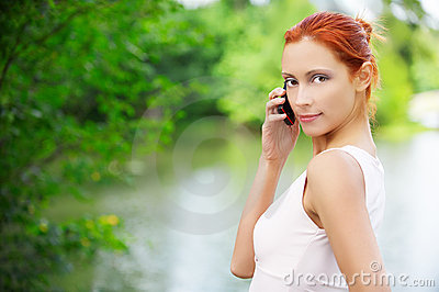 Girl with cellphone outdoors