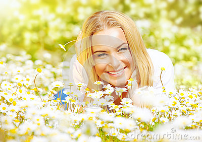 Girl on chamomile glade