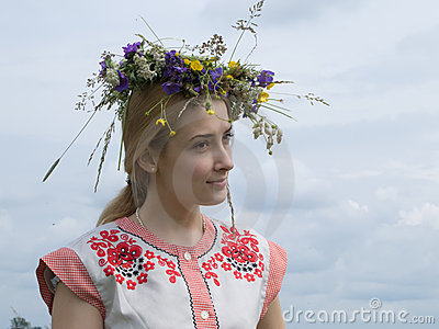 Girl in a chaplet from meadow flowers