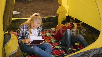 Girl Check Notebook Boy Play Guitar Camping stock video footage