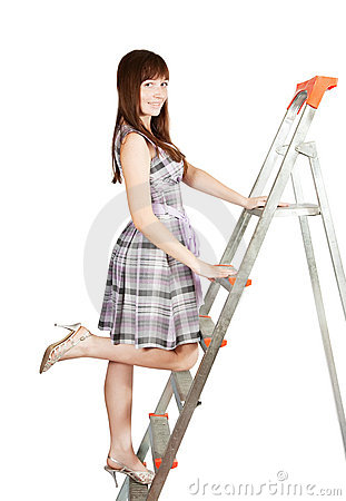 Girl in checked dress on stepladder