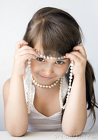 Girl child with bead