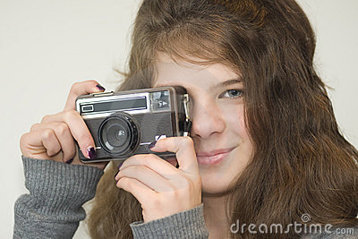 Girl child with camera