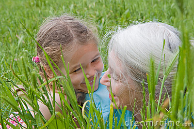 Girl child and Grandmother having fun outside
