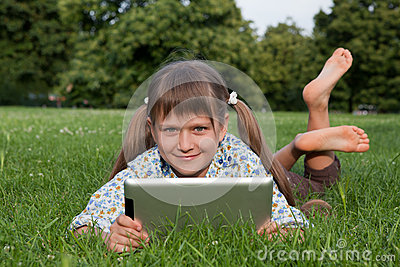 Girl child holding tablet wireless computer rel