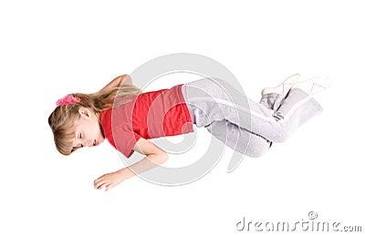 Girl child sleep on floor.