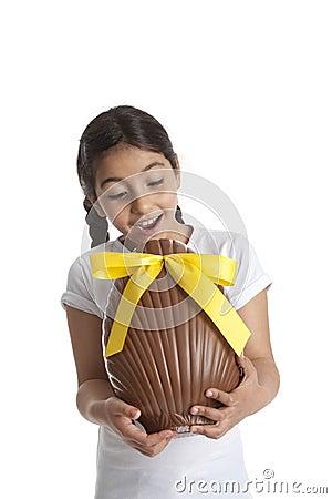 Girl with chocolate easter egg