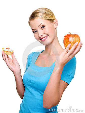 Girl choose from sweet cake and fresh apple