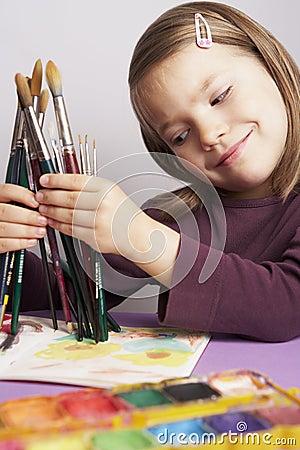 Girl choosing a paint brush