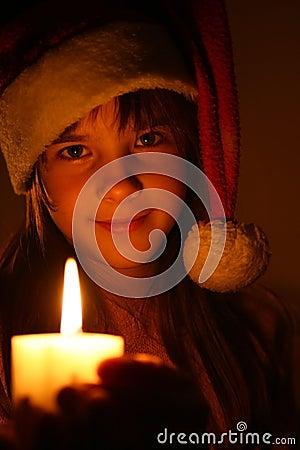 Girl with christmas candle