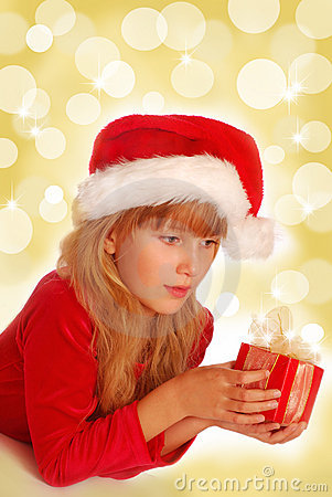 Girl with christmas gift on shining background