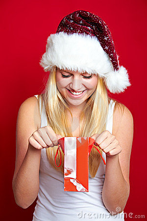 Girl on Christmas with gifts