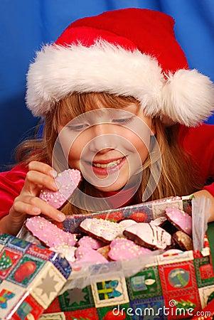 Girl and christmas gingerbreads