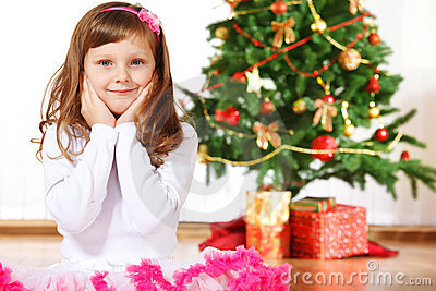 Girl beside Christmas tree
