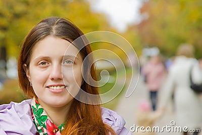 Girl  on city street in autumn