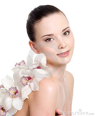 Girl with clean skin and with flowers