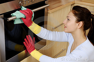 Girl cleaning the house