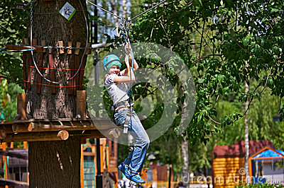 Girl is climbing on obstacle course
