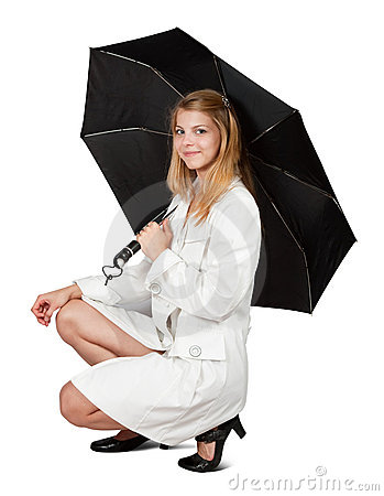 Girl in cloak with umbrella