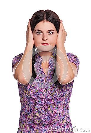 Girl closes ears
