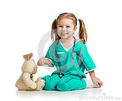 Girl with clothes of doctor playing with toy over white