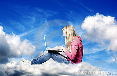 Girl in the clouds with laptop