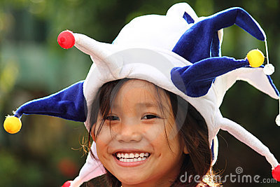 Girl in clown hat